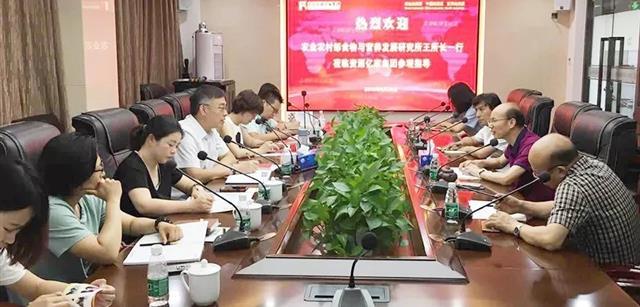 农业农村部食物与营养发展研究所王晓红副所长率猪课题小组到访资源集团调研生态猪肉产业